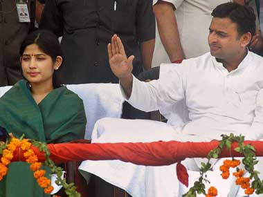 Akhilesh Yadav with wife Dimple (left). PTI