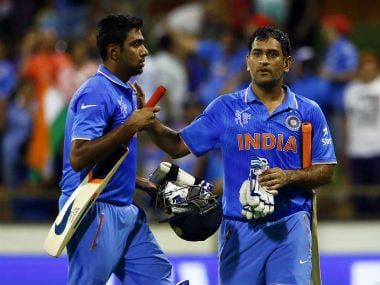 File photo of Ashwin (L) and Dhoni. Reuters