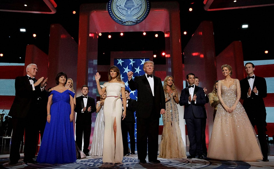 President Donald Trump acknowledges the crowd with first lady Melania Trump, Vice President Mike Pence and his wife Karen, left, and their families at the Freedom Ball. Americans and even the global geopolitical order will be fervently hoping that Trump proves competent enough for the job. AP