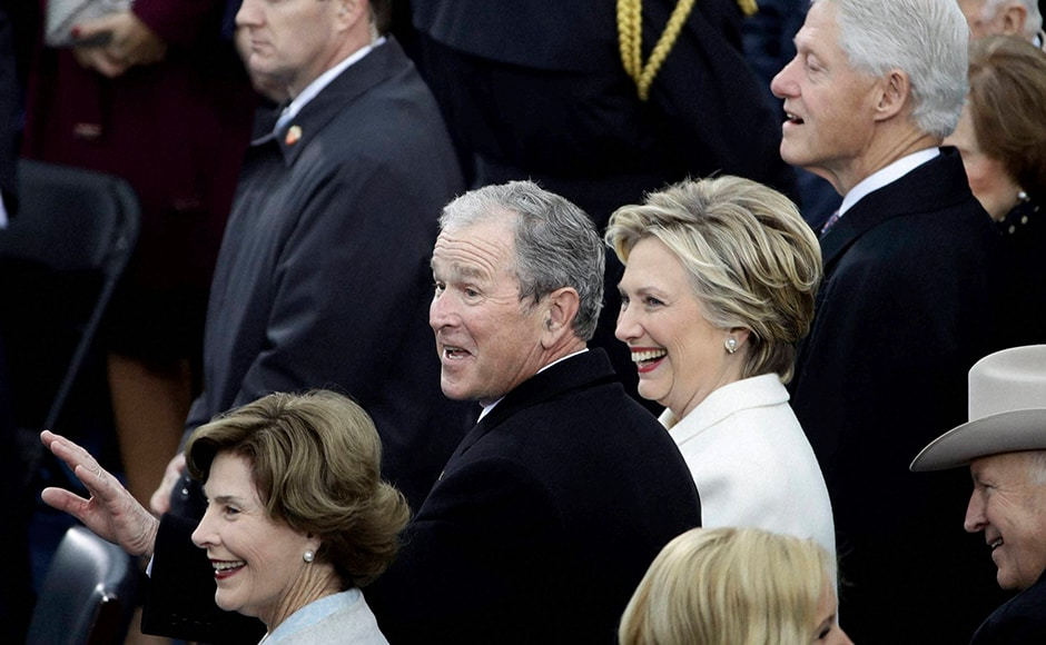 Dressed in an elegant powder white pant suit, designed by Ralph Lauren, Former Secretary of State Hillary Clinton appeared poignant and graceful as she watched the ceremony commences. AP