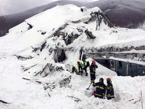 File photo of Italian firefighters searching for survivors after an avalanche. AP
