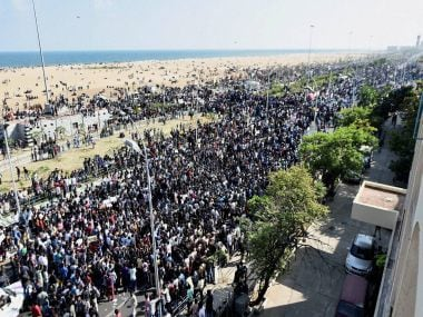 Youths protesting on Marina Beach in Chennai on Wednesday. PTI
