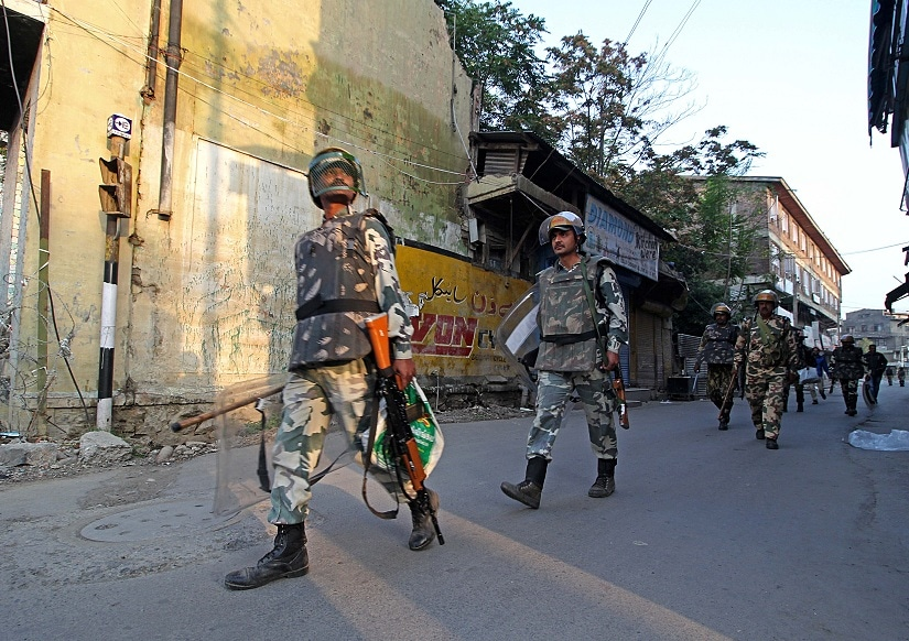 A patrolling party of the CRPF moves towards old town area of Srinagar on a December morning. Photo courtesy Faisal Khan