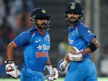 Virat Kohli (R) and Kedar Jadhav run between the wickets during first ODI against England in Pune. Reuters