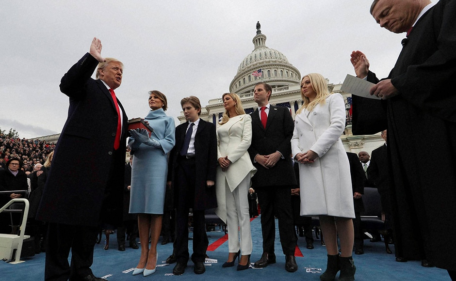 At Trump's side was his wife, Melania Trump donning a cashmere turtleneck dress that fell to her knee, paired with a cropped bolero jacket and matching suede gloves. AP