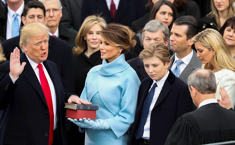 As scattered protests erupted elsewhere in Washington, Trump raised his right hand and put his left on a Bible used by Abraham Lincoln and repeated a 35-word oath of office from the U.S. Constitution, with U.S. Chief Justice John Roberts presiding. AP