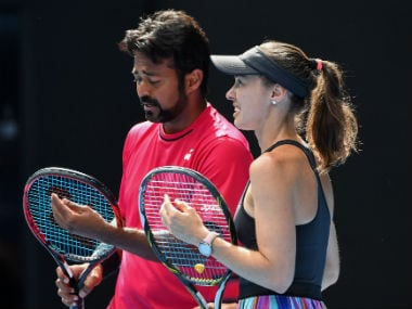Paes and Hingis during their mixed doubles second round match of the Australian Open. AFP