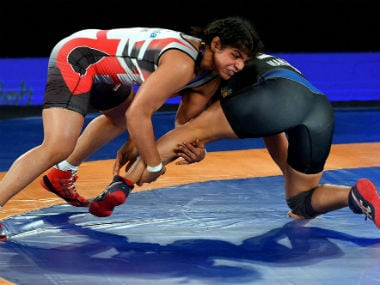 Sakshi Malik (L) fights Manju Kumari during the PWL in New Delhi. PTI