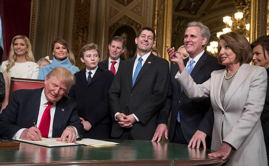 President Donald Trump was joined by the Congressional leadership and his family as he formally signed his cabinet nominations into law, in the President's Room of the Senate, at the Capitol in Washington. AP