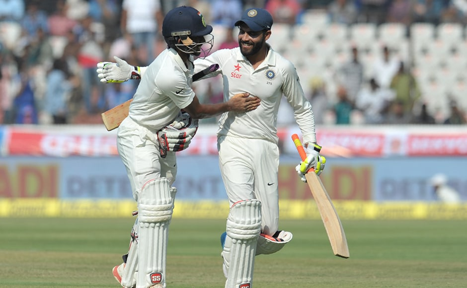 India's Ravindra Jadeja (R) and Wriddhiman Saha walk off the field after India declared on the second day of a solo Test match between India and Bangladesh at the Rajiv Gandhi International Cricket Stadium in Hyderabad on February 10, 2017. IMAGE RESTRICTED TO EDITORIAL USE - STRICTLY NO COMMERCIAL USE----- / GETTYOUT NOAH SEELAM / AFP