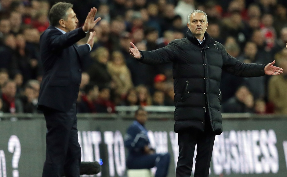 Southampton's manager Claude Puel, left, and Manchester United's manager Jose Mourinho gesture during the English League Cup final. AP