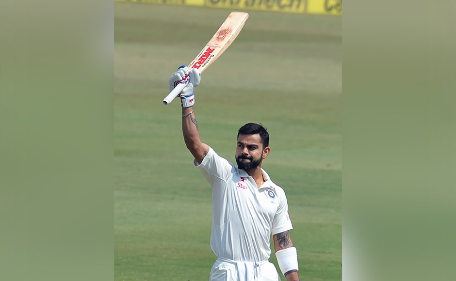 India's captain Virat Kohli raises his bat for his double century (200 runs) on the second day of the Test cricket match between India and Bangladesh at The Rajiv Gandhi International Cricket Stadium in Hyderabad on February 10, 2017. ------IMAGE RESTRICTED TO EDITORIAL USE - STRICTLY NO COMMERCIAL USE----- / GETTYOUT NOAH SEELAM / AFP