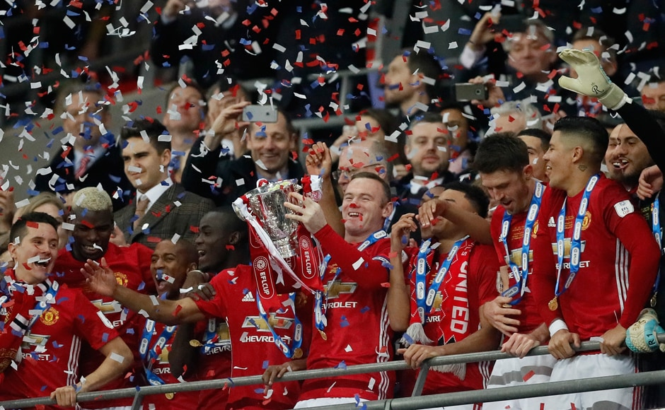 Manchester United's Wayne Rooney lifts the trophy after they won the English League Cup against Southampton FC at Wembley Stadium in London. AP