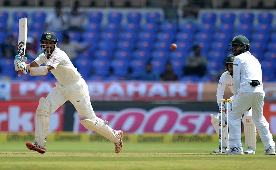 Run-machine Cheteshwar Pujara finds the gap and whacks a handsome shot to start the proceedings for India. AP