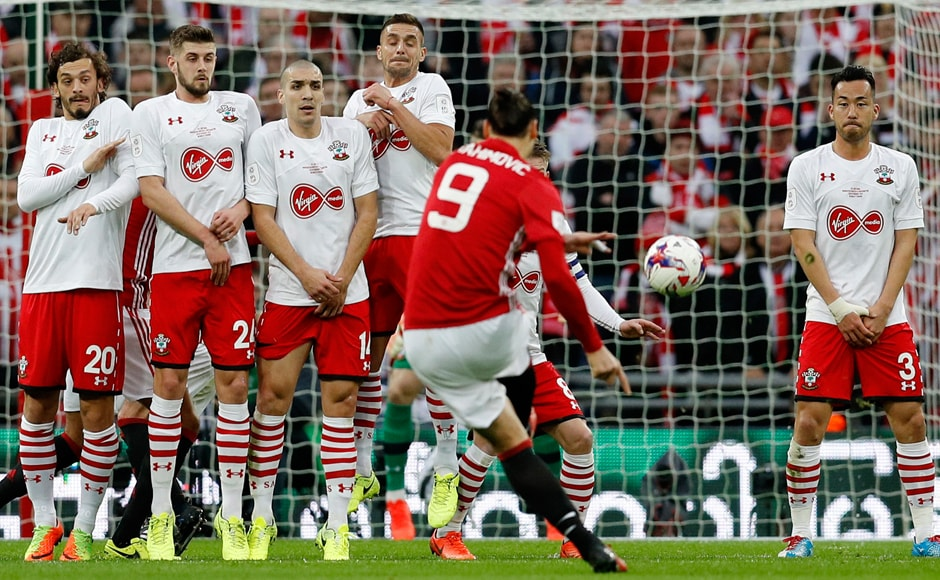 Manchester United's Zlatan Ibrahimovic scores their first goal from a free kick. Reuters