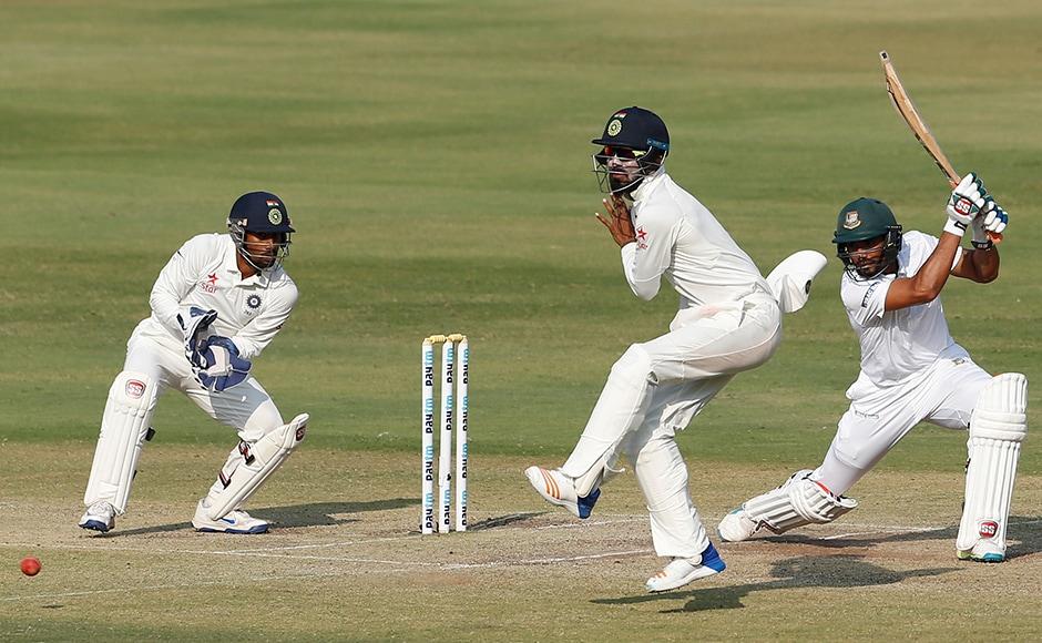 Mahmudullah's cover-drive went through Lokesh Rahu's leg as Bangladesh chased 459 during the fourth day. AP Photo