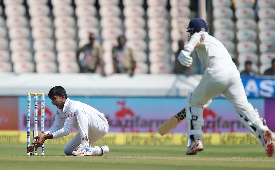 How can Mehedi Hasan miss that? Murali Vijay escaped a run-out scare in the 19th over of the match on Day 1. AP