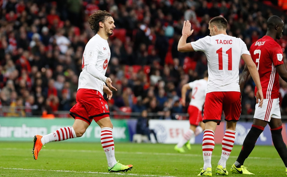 Southampton's Manolo Gabbiadini, left, celebrates after scoring his side's first goal just before half-time. AP