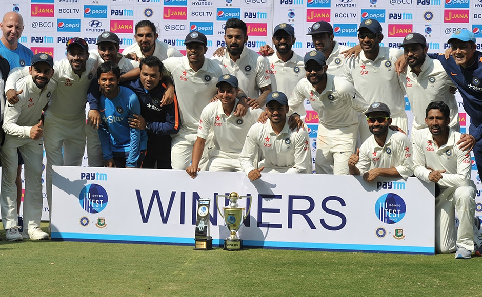 India's cricket team poses with the trophy after winning a solo Test match against Bangladesh at the Rajiv Gandhi International Cricket Stadium on February 13, 2017. IMAGE RESTRICTED TO EDITORIAL USE - STRICTLY NO COMMERCIAL USE----- / GETTYOUT