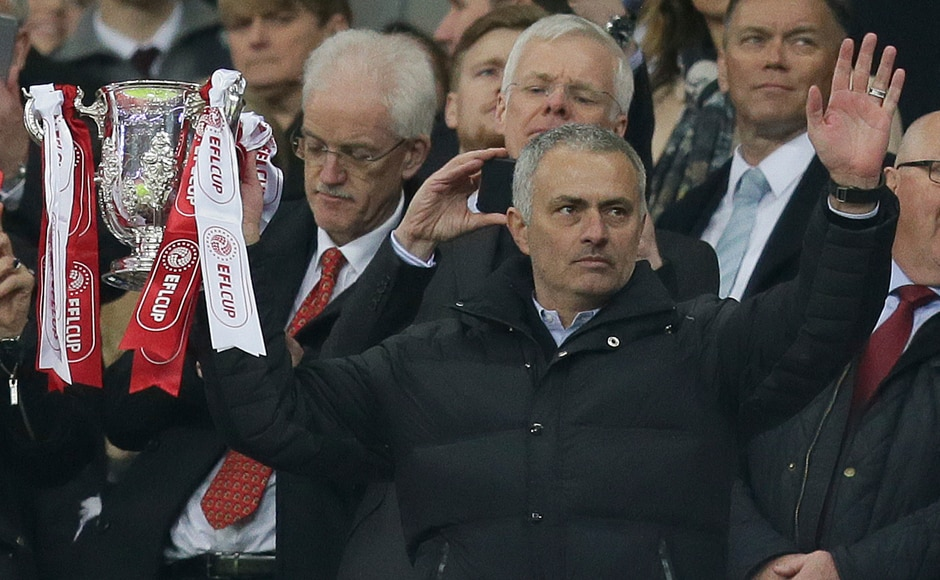 Manchester United's manager Jose Mourinho holds the trophy after his team won the League Cup final. AP