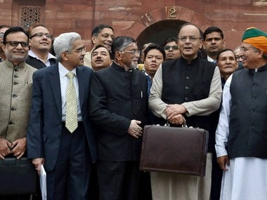New Delhi: Finance Minister Arun Jaitley (C) stands outside his office at North Block holding the briefcase containing the Union budget for 2017 and is flanked by MoS Arjun Meghwal (2nd R) and Santosh Gangwar (3rd L), on Wednesday,in New Delhii. PTI Photo by Vijay Verma(PTI2_1_2017_000007B)