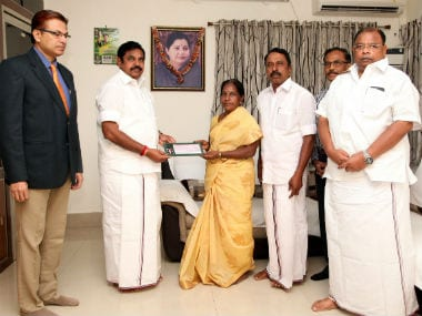Bhavani Devi's mother receives the present by the Tamil Nadu government. Image Credit: Twitter: @AIADMKOfficial