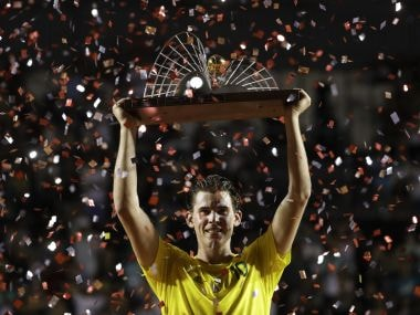 Dominic Thiem raises his trophy after defeating Pablo Carreno Busta in the final of the Rio Open. AP