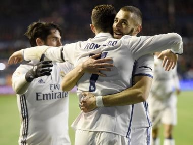 Real Madrid's Cristiano Ronaldo is congratulated by teammate Karim Benzema after scoring. AFP