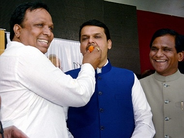 Maharashtra Chief Minister Devendra Fadanvis celebrates his party's performance in the BJP elections. PTI