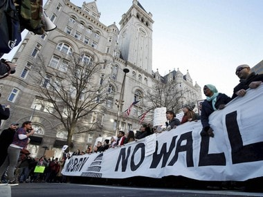Protesters march along Pennsylvania Avenue past the Trump International Hotel during a rally protesting the immigration policies of President Donald Trump. AP