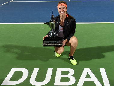 Elina Svitolina poses with the trophy after defeating Caroline Wozniacki in the final. Getty Images