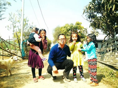PRJA candidate Erendro Leichombam blowing whistles with a group of children at Neikalong in the Assembly constituency of Thangmeiband in Manipur. Whistle is the party symbol of PRJA. Image from Erendro Leichombam's Facebook page