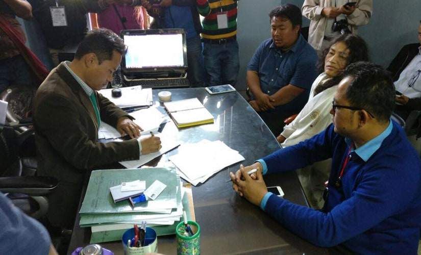 Erendro Leichombam accompanies PRJA leader Irom Sharmila Chanu as she files her nomination at Thoubal Aseembly constituency on 16 February 2017. Image from Erendro Leichombam's Facebook page