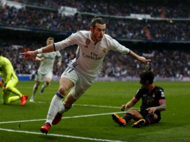 Real Madrid's Gareth Bale celebrates after scoring past Espanyol's goalkeeper Diego Lopez. AP