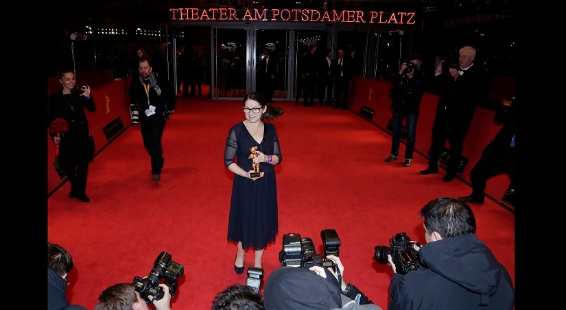 Ildiko Enyedi poses for photographers with the Golden Bear Best Film award for 'On Body and Soul' at the award ceremony at the 2017 Berlinale Film Festival in Berlin, Germany, Saturday, Feb. 18, 2017. (AP Photo/Markus Schreiber)
