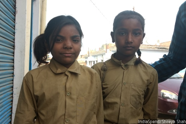 Eight-year-old Saidun Ahmed (left) on her way to school in Fattepur village, Mirzapur district in eastern Uttar Pradesh, said she couldn't read well. Poor quality education and high absenteeism plague government schools in the state. Indiaspend/Shreya Shah