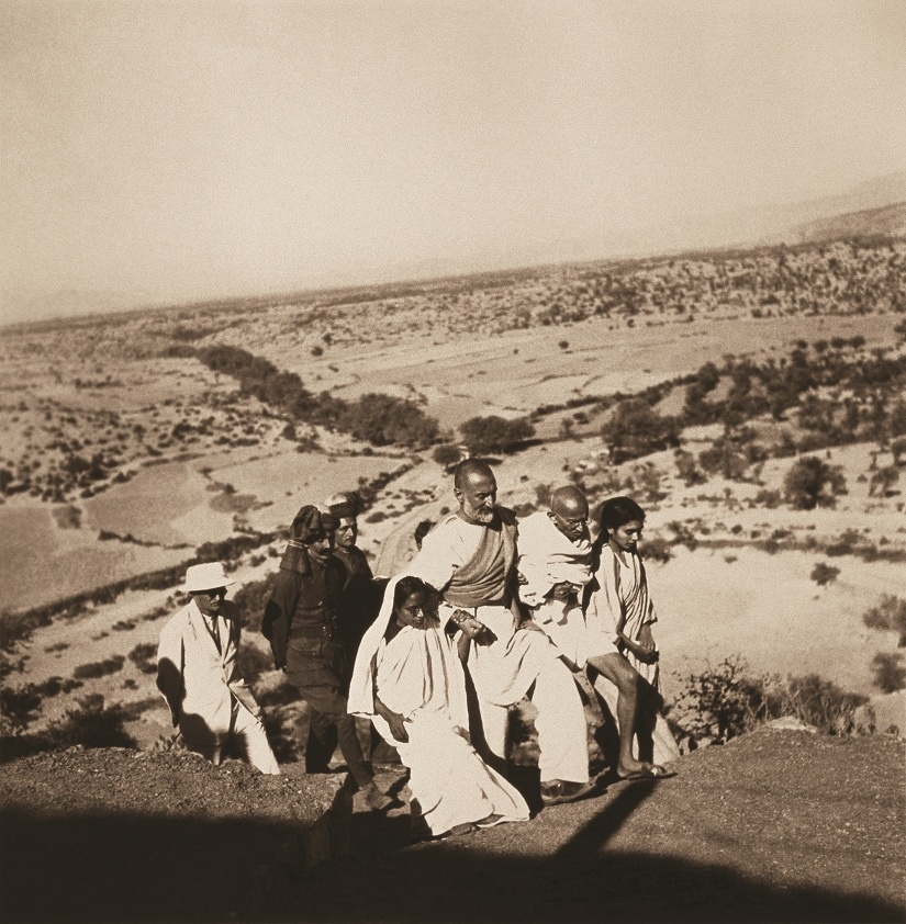 North West Frontier Provinces: Dr. Sushila Nayar, Mahatma Gandhi, Khan Abdul Ghaffar Khan, Amtus Salam (from right to left) and others walking in the countryside, October 1938. From Nazar Photography Monographs 03 – KANU'S GANDHI. Photograph by Kanu Gandhi / © Gita Mehta, heir of Abha and Kanu Gandhi.