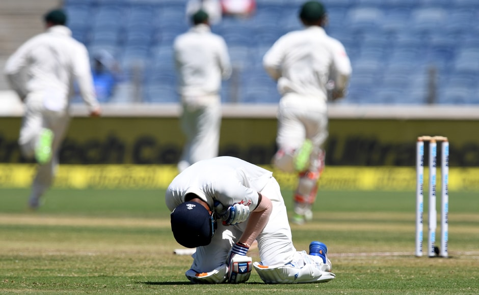 KL Rahul falls to the ground, having hurt his left shoulder while getting dismissed in the first innings. AFP