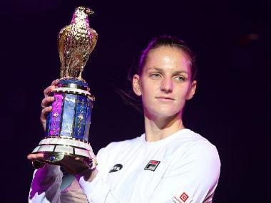Karolina Pliskova with the trophy after winning the Qatar Open women's singles final. AFP