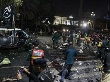Police and security officers cordon off the area of a deadly bombing, in Lahore, Pakistan. AP