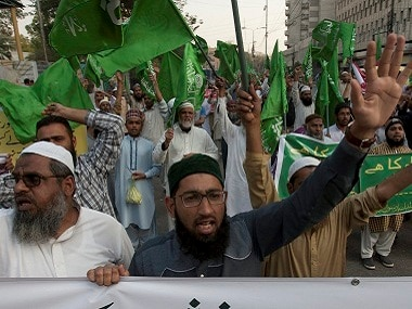 In Karachi, people protest against a recent attack at a shrine. PTI