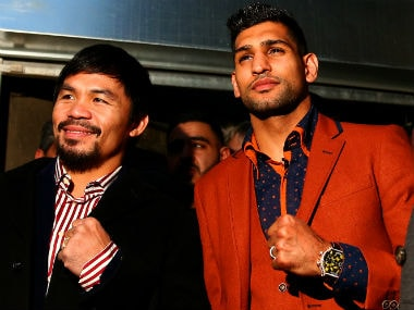 Manny Pacquiao and Amir Khan confirm their match via Twitter. Getty Images
