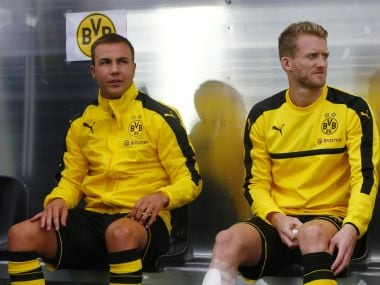 File photo of Borussia Dortmund's Mario Gotze and Andre Schurrle on the bench. Reuters