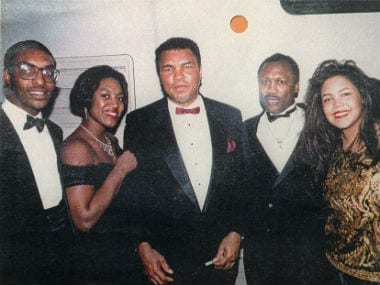 Muhammad Ali posing with, Joe Frazier (R), wife and Muhammad Ali Jr (L). Getty Images