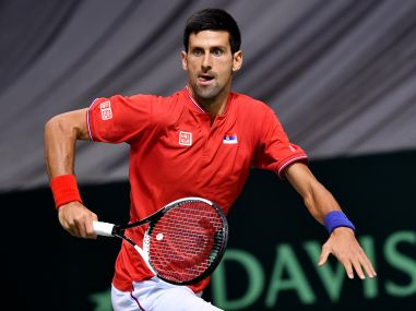 Novak Djokovic runs to return the ball to Daniil Medvedev during the Davis Cup World Group first round. AFP