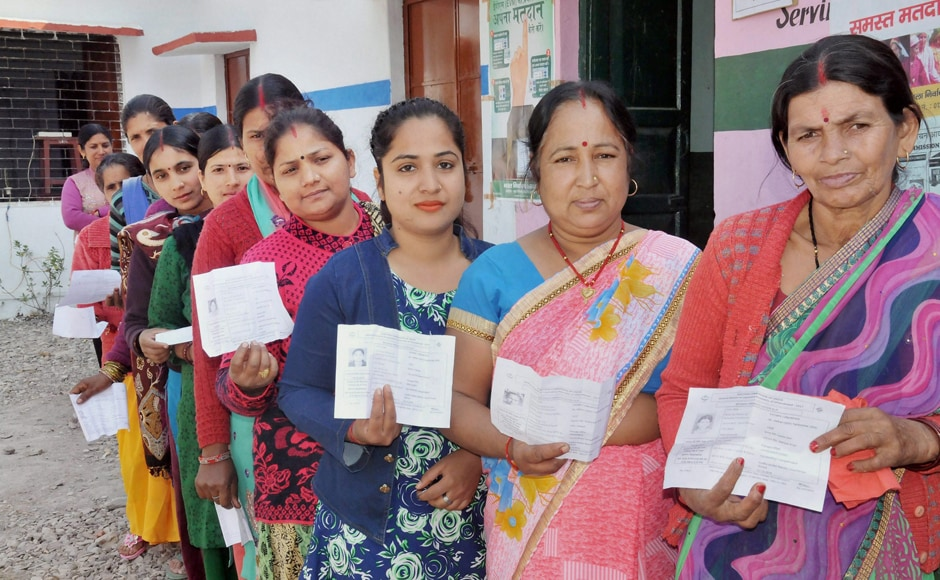 Women at a polling booth in Haridwar stand in line to cast their vote during the Uttarakhand Assembly election on Wednesday. PTI