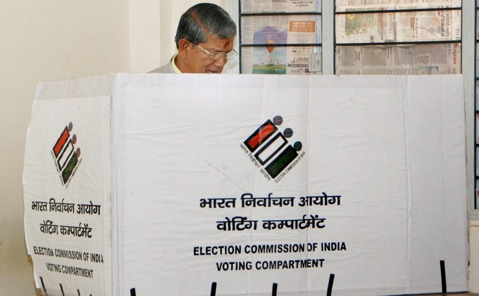 chief minister Harish Rawat casts his vote at ITI Majara polling station in Dehradun on Wednesday. PTI