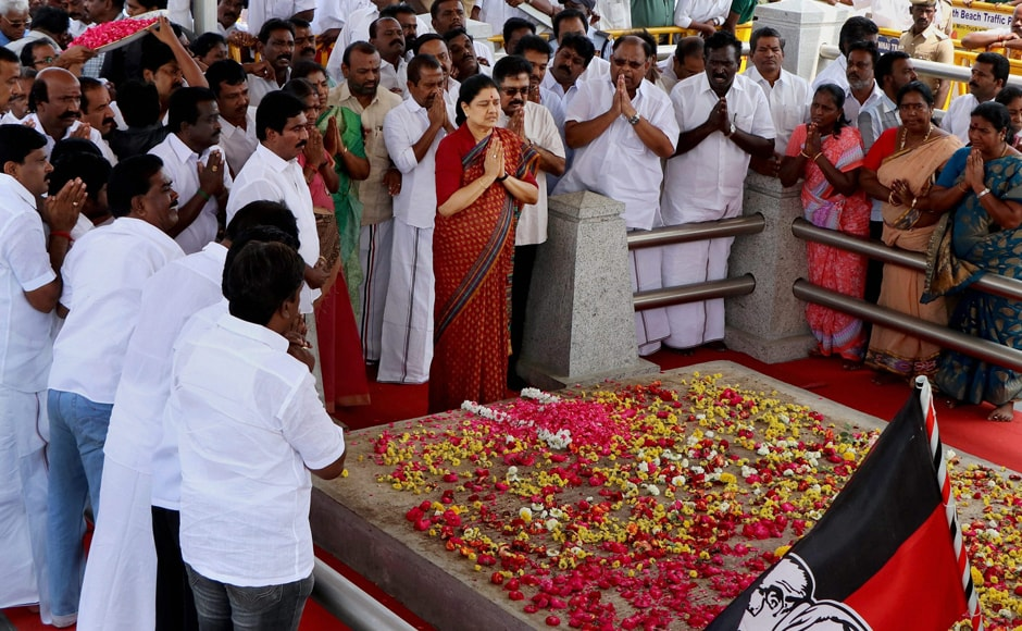 In dramatic gestures, an emotional Sasikala went around the burial site, muttered something and tapped on the tomb thrice and prayed and prostrated. PTI