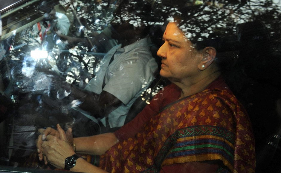 Sasikala arrives to surrender at the special court after she convicted in DA case in Bengaluru on Wednesday. PTI
