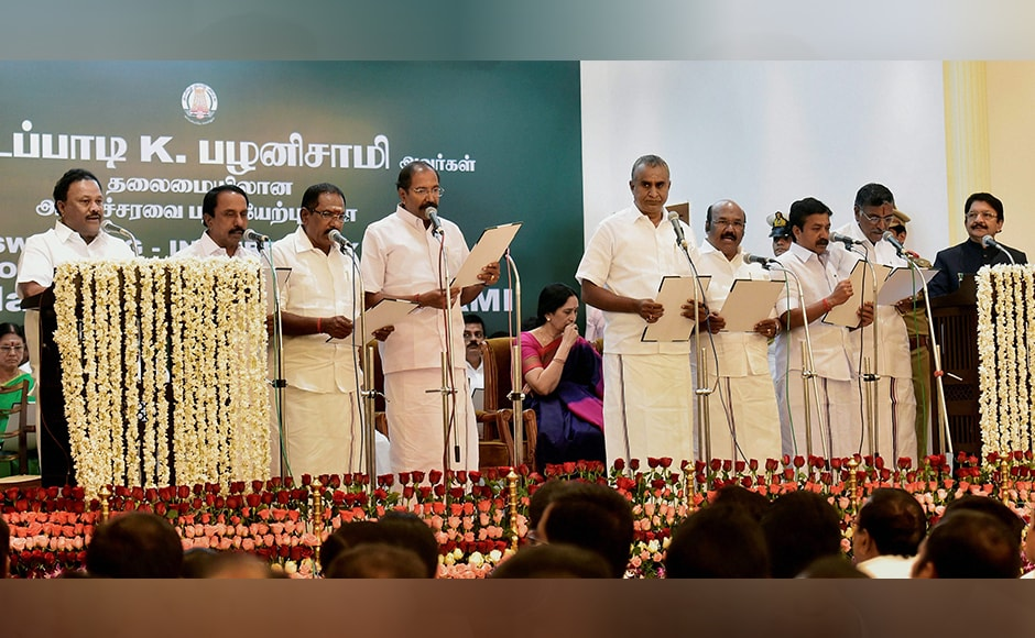 Senior AIADMK leaders part of the new Council of Ministers taking the oath of secrecy following chief minister Palaniswami's appointment at the Raj Bhavan in Chennai on Thursday. PTI